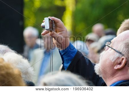 BERLIN - MAY 08 2015: Victory in Europe Day. Treptower Park. Participants of commemorative events. The man with photo camera.