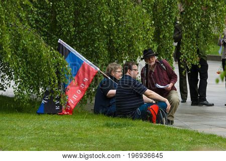 BERLIN - MAY 08 2015: Victory in Europe Day. Treptower Park. Participants of commemorative events with the flags of the People's Republic of Donetsk.