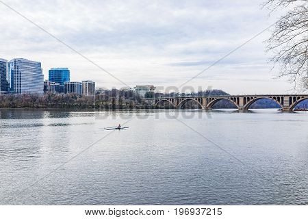 Washington Dc, Usa - March 20, 2017: Woman Rowing On Boat On Potomac River With Skyline Or Cityscape