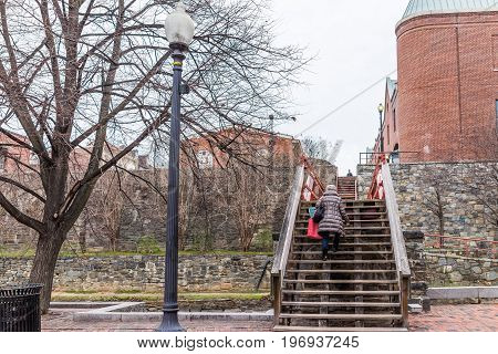 Washington Dc, Usa - March 20, 2017: Georgetown Bridge With Person Walking On It Over Canal