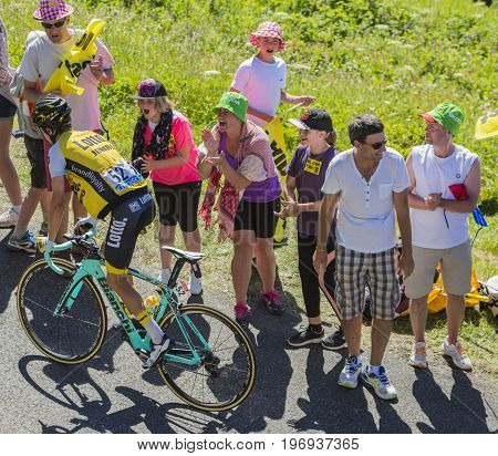 Col du Grand ColombierFrance - July 17 2016: The New Zealand cyclist George Bennett of LottoNL-Jumbo Team riding on the road to Col du Grand Colombier in Jura Mountains during the stage 15 of Tour de France 2016.