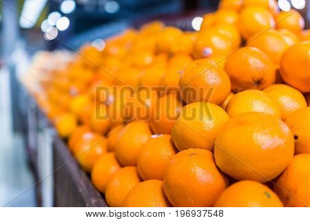 Macro Closeup Of Many Oranges In Pile On Display In Store