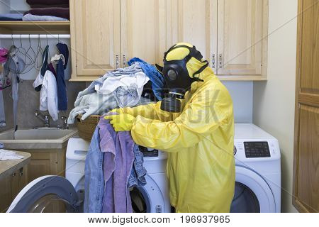 Woman In Haz Mat Suit Sorting Laundry