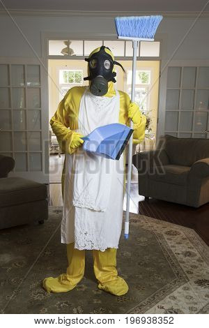 Mature Woman In Haz Mat Suit With Blue Broom And Dust Pan