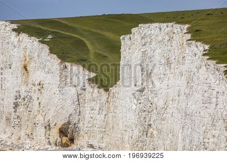 A close-up view of the Seven Sisters white chalk cliffs in East Sussex UK.