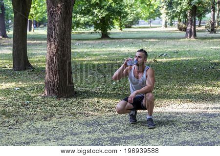 He Rests After Training And Drinks Water