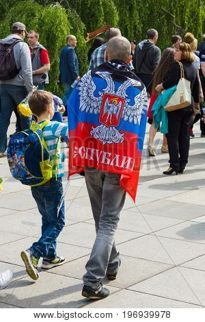 BERLIN - MAY 09 2015: A man with a frag Donetsk People's Republic.