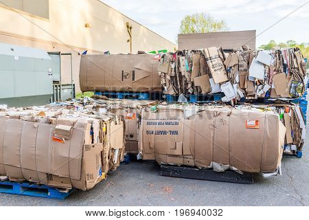 Burke, Usa - April 16, 2017: Compacted Cardboard Boxes Behind Walmart Store Building
