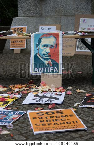 BERLIN - MAY 09 2015: Victory Day. Posters antifascists in front of the main entrance in Treptow Park.