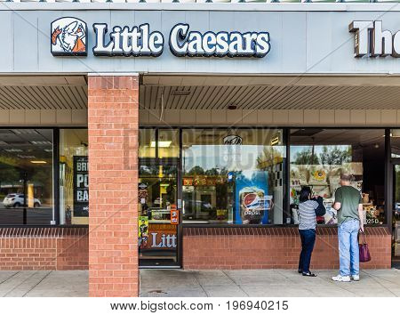 Burke, Usa - April 16, 2017: Little Caesars Pizza Chain Building Exterior With Sign And Logo