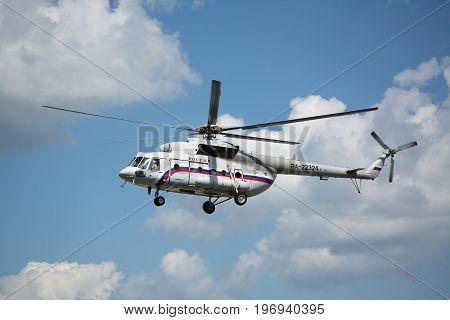 Yoshkar-Ola, Russia - Jule 19, 2017 Presidential helicopter of Vladimir Putin Mil Mi-8 in the sky over Yoshkar-Ola, Russia