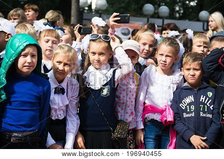 Yoshkar-Ola, Russia - September 1, 2016 Photo of schoolchildren during the solemn start of the new school year in the central park of Yoshkar-Ola, Russia