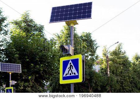 Photograph of a traffic light using a solar battery on a pedestrian crossing