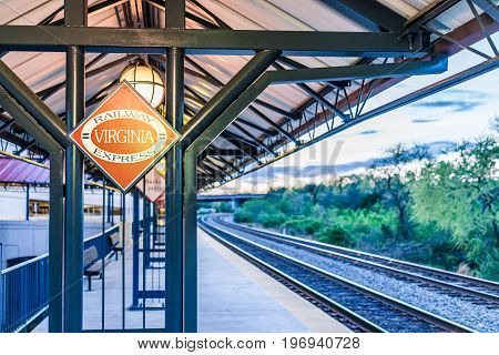 Burke, Usa - April 16, 2017: Burke Centre Train Station Platform With Railway Virginia Express Sign