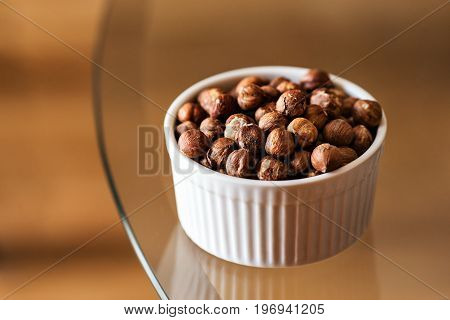 Closeup of organic peeled hazelnuts in a bowl health concept