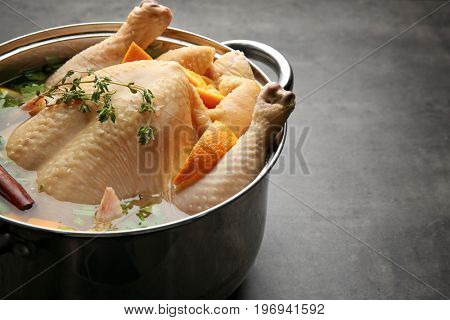 Cooking pot with turkey soaked in flavored brine