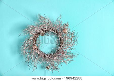 Beautiful trendy Christmas wreath on color background
