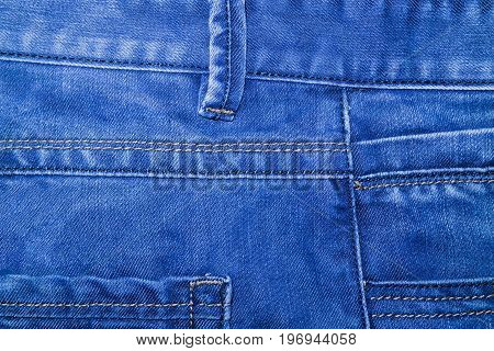Photo of blue jeans piece of clothing denim closeup