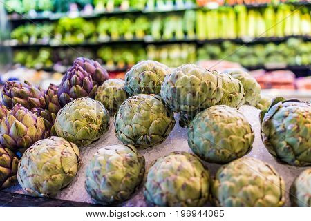 Many fresh artichokes on display in market