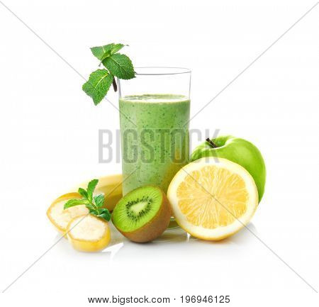 Glass of fresh juice and fruits  on white background