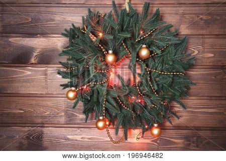 Beautiful trendy Christmas wreath on wooden background