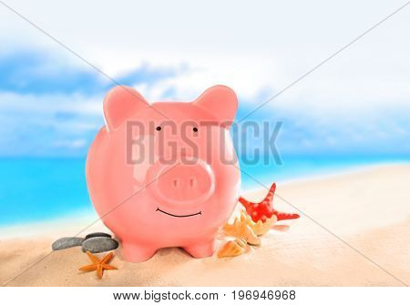 Piggy bank on beach. Concept of money for vacation