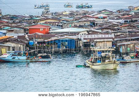Semporna,Sabah,Malaysia-Apr 22,2017:View of Semporna bajau water village in Semporna,Sabah,Malaysia.The water village is a popular tourist attraction place in Semporna,Sabah,Borneo,Malaysia