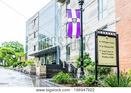 Scranton, Usa - May 25, 2017: University Of Scranton Purple Flag And Building With Sign Stating Dire