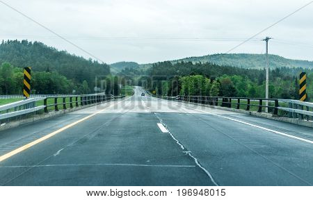 Highway 87 in New York state with car on road during rainy stormy day