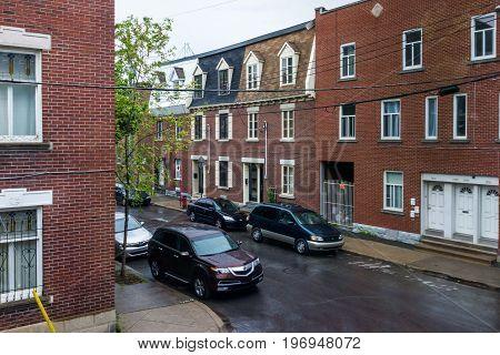 Montreal, Canada - May 25, 2017: Residential Brick Buildings In Quebec Region In Sainte Marie Neighb