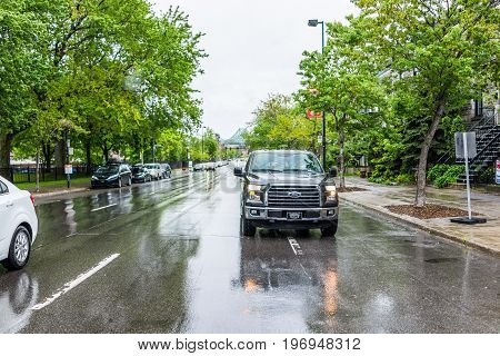 Montreal, Canada - May 26, 2017: Car On Avenue De Lorimier Road During Rainy Cloudy Day In Quebec Re