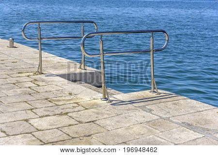 Metal ladder for descent into the sea water.