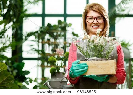 Happy woman with flower box