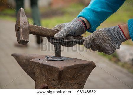 Background metalwork anvil hammer male forging horseshoe outdoor