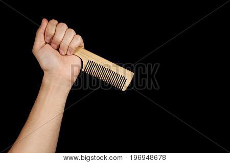 The Fist Wooden Comb Inverted Tooth Diagonal, Isolated On Black Background