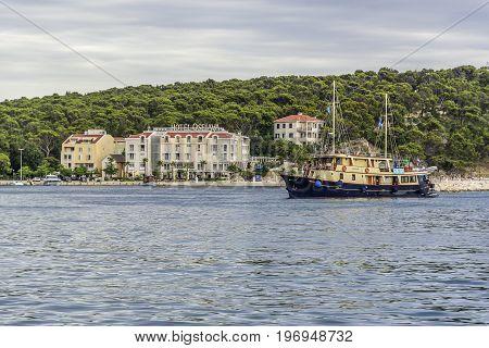 MAKARSKA RIVIERA, CROATIA - 1 JULY, 2017: Embankment in the resort town of Makarska on a summer day. Makarska, one of the most popular destinations for beach holidays for tourists in Croatia.