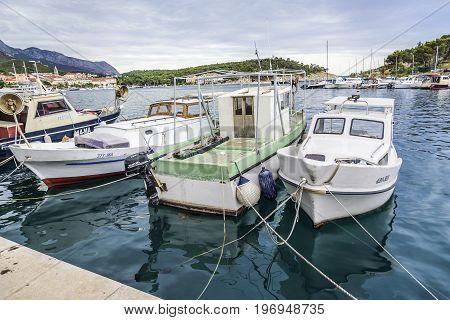 MAKARSKA RIVIERA, CROATIA - 1 JULY, 2017: Boats on the pier in the resort town of Makarska, Croatia.