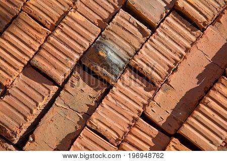 Background closeup orange new bricks concept construction
