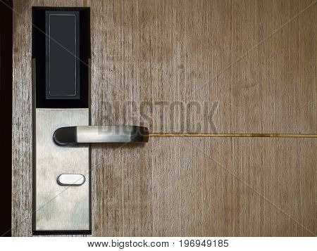 Wooden open door with silver metal handle Security.