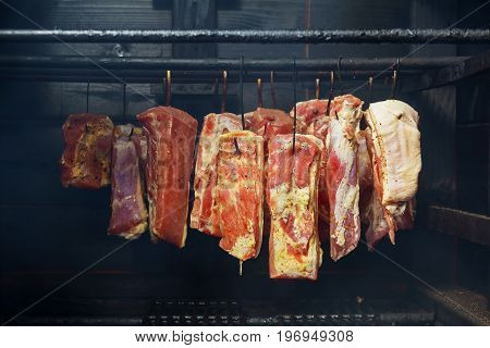 Hanging Ham In The Smokehouse