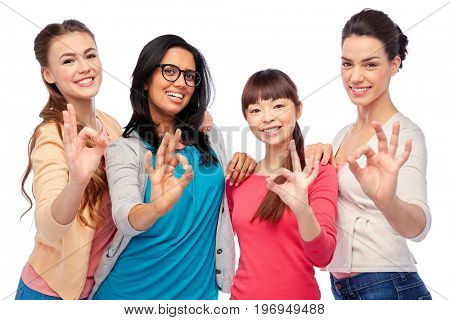 diversity, race, ethnicity and people concept - international group of happy smiling different women over white showing ok hand sign