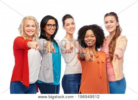 diversity, race, ethnicity and people concept - international group of happy smiling different women over white pointing finger at you