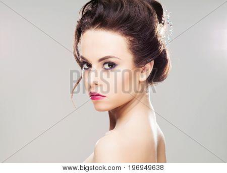 Portrait of gorgeous brunette wearing luxury headband over isolated background.