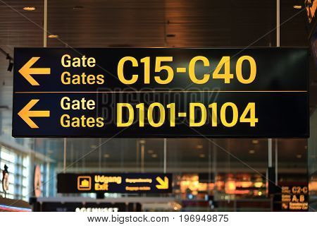 Signs with gates numbers in airport. Background of modern airport.