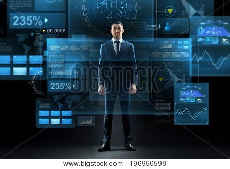business, technology and people concept - businessman in suit and virtual screens over black background