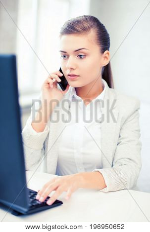 business concept - smiling businesswoman with smartphone in office