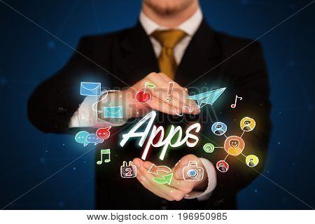 Businessman with drawn application icons and symbols in his hands