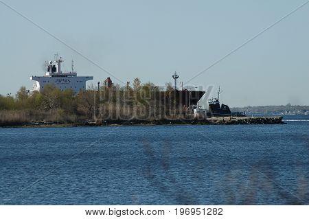 East Providence Rhode Island USA - April 30 2006: Ship and tug docked along Providence River