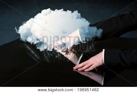 Male hands touching interactive table with a white cloud on it