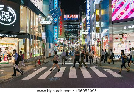 Shibuya District Of Tokyo In Evening With People On Streets